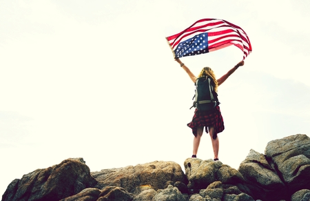 Woman holding up American flag