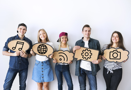 Young diverse friends holding social media icons Stock fotó