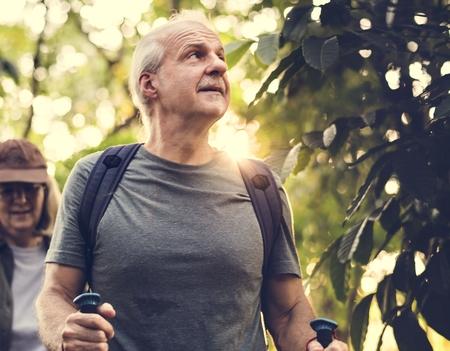 Seniors trekking in a forest