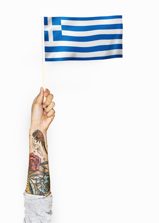 Person waving the flag of Greece