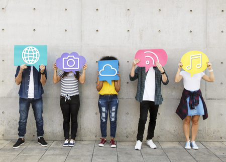 Teenagers covering their faces with social media icons 版權商用圖片 - 110372798