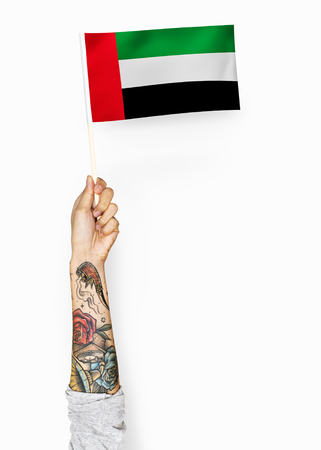 Hand showing flag of United Arab Emirates