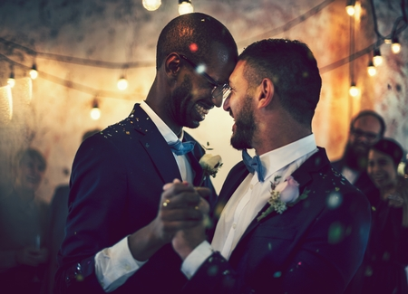 Gay couple dancing on their wedding day