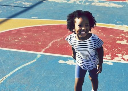 Cute girl on a basketball court