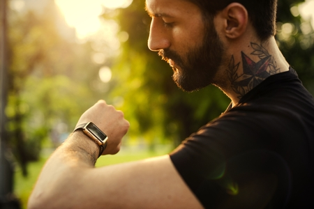 Man looking at his smartwatch Stock Photo - 110107237