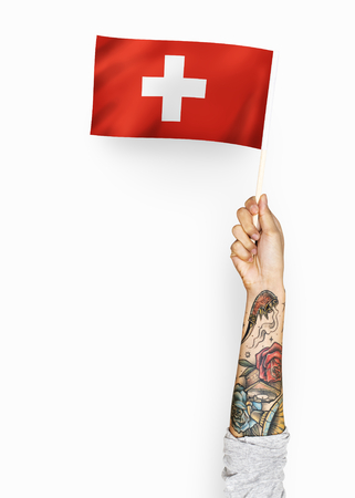 Person waving the flag of Switzerland