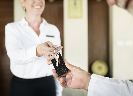 Receptionist handing over the room key
