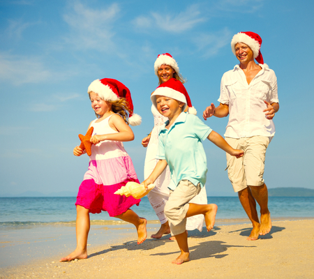 Family enjoying a Christmas holiday at the beach