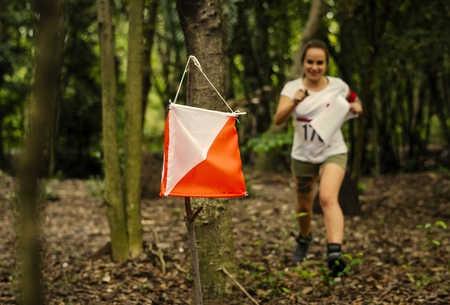 Woman racing to an orienteering check point