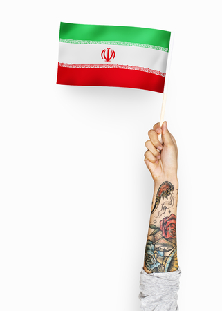 Person waving the flag of Islamic Republic of Iran Stok Fotoğraf