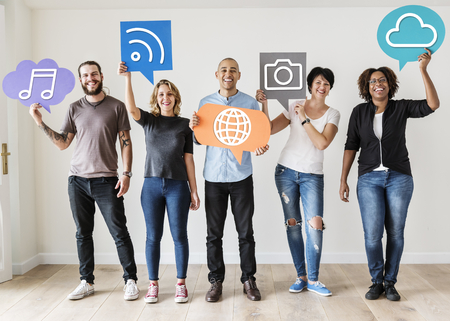 Diverse friends holding social media icons