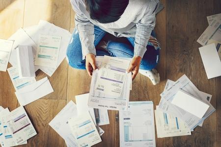 Woman going through her bills