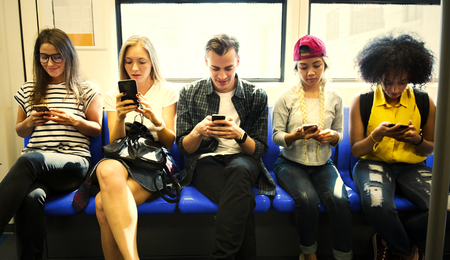 Young people attached to their smartphones Stock Photo
