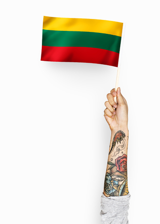 Person waving the flag of Republic of Lithuania