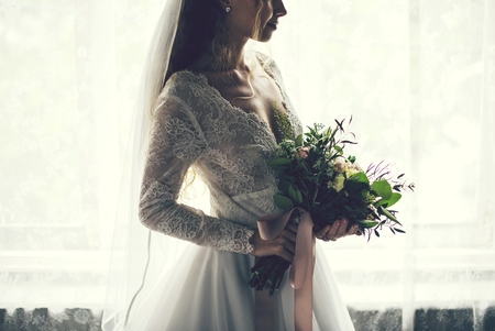 Beautiful bride with a flower bouquet