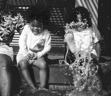 Kids splashing in a pool