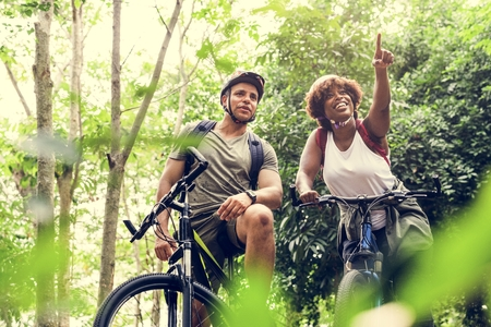Cyclist couple in the forest