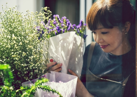 Japanese woman working in a flower shop