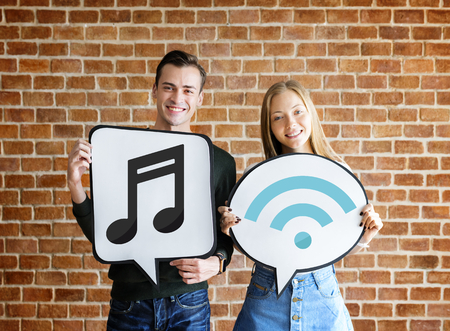 Young couple holding social media icons
