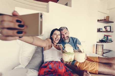 Couple relaxing on the bed