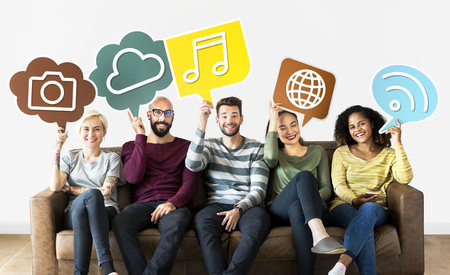 Cheerful people holding social media icons