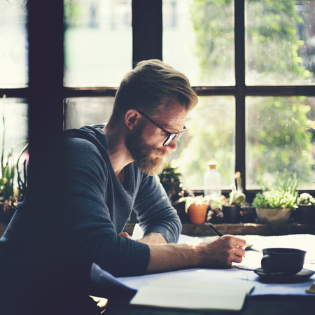 Bearded man working on a plan