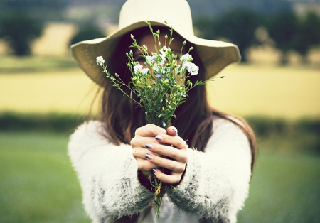 Woman holding a bouquet of wild flowers Stock Photo
