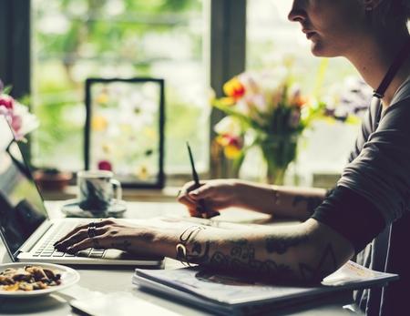 Creative woman working on a laptop Banco de Imagens