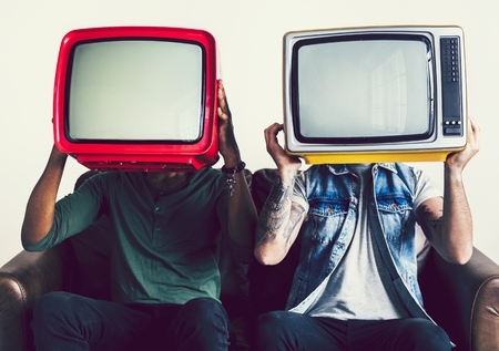 People holding up retro televisions