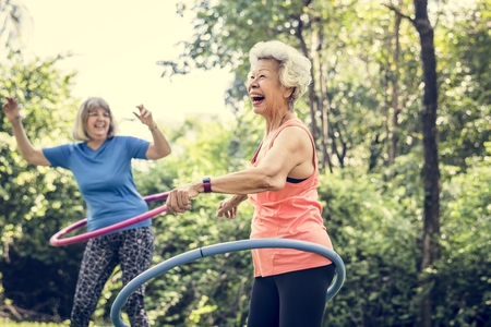 Senior woman exercising with a  hoop Stock Photo