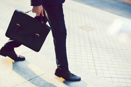 Man carrying his briefcase to work Stock Photo