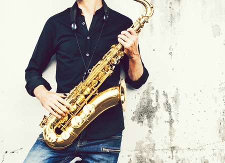 A musician with his saxophone Stock Photo