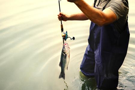 Man fishing by the lake Stockfoto - 110449704