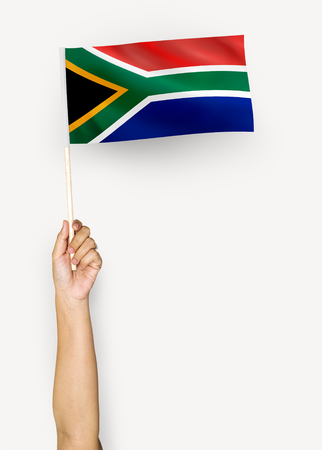 Person waving the flag of Republic of South Africa