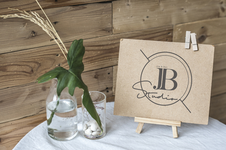 Craft paper display on a table mockup Фото со стока - 110450136