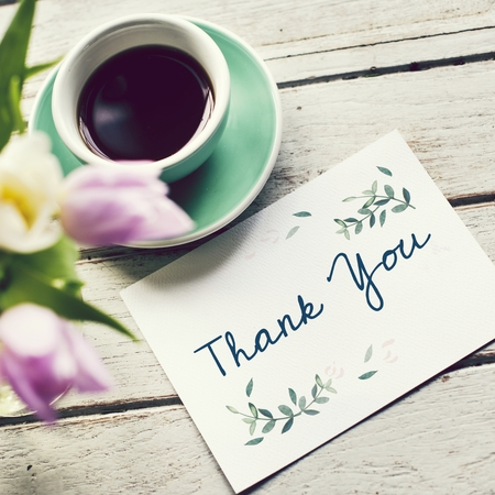 Thank you note with a cup of coffee