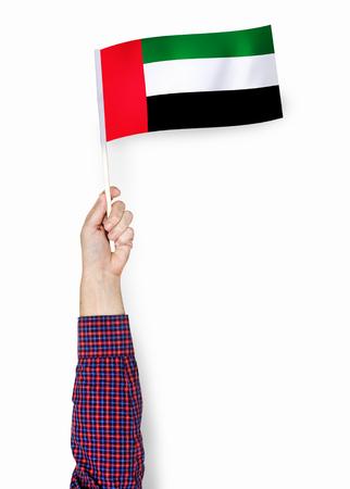 Hand showing flag of United Arab Emirates