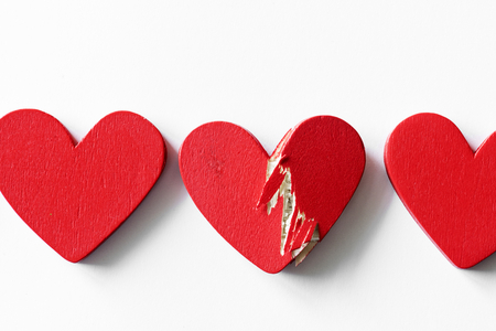 Closeup of red hearts on white background
