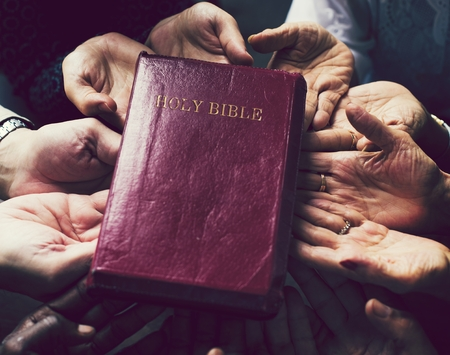 People with faith in the holy bible