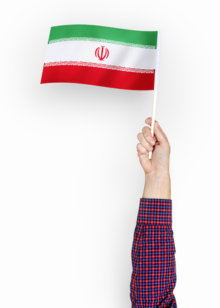Person waving the flag of Islamic Republic of Iran Reklamní fotografie