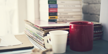 Books and coffee cups on a table Stock Photo