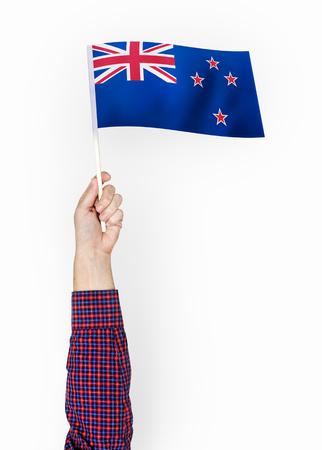 Person waving the flag of New Zealand