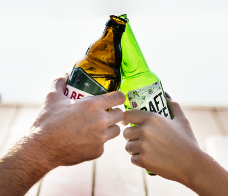 A toast with beer bottles Stock Photo