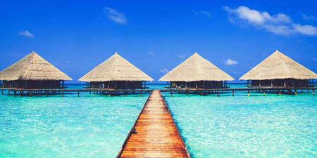 Huts in the blue sea of Maldives