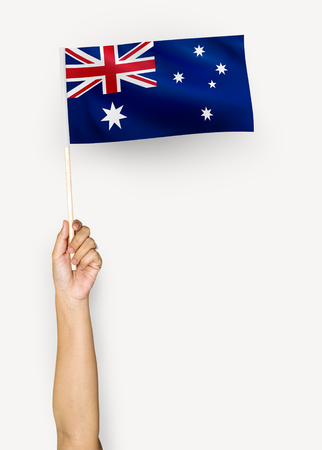 Person waving the flag of Commonwealth of Australia Reklamní fotografie