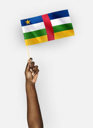 Person waving the flag of the Central African Republic