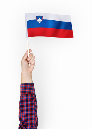 Person waving the flag of Republic of Slovenia