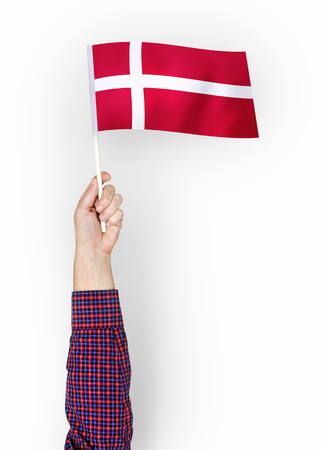 Person waving the flag of Kingdom of Denmark