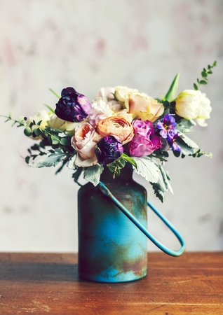 Rustic vase with a beautiful bouquet on table