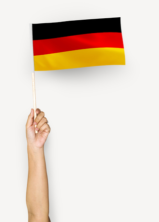 Person waving the flag of Federal Republic of Germany Stock Photo